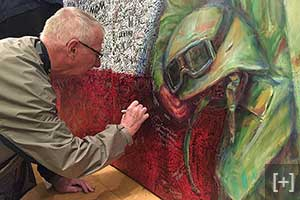 ArtPrize Seven visitors honored their heroes by writing hero messages on the Hometown Hero painting